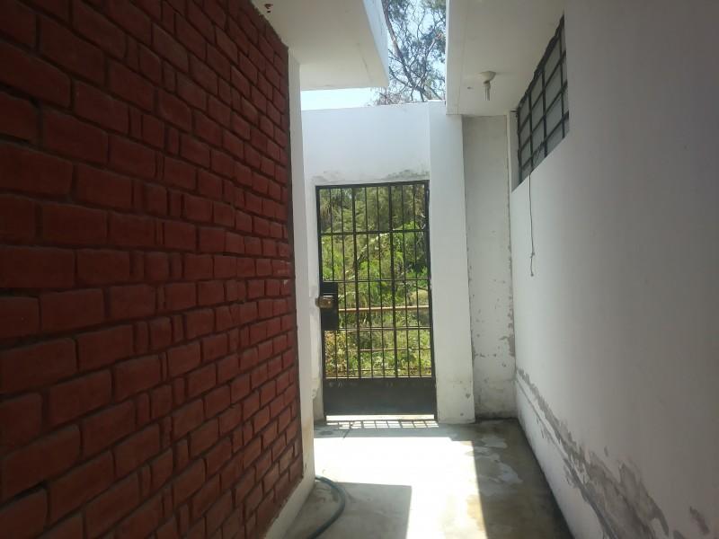 Door to Sanctuary Behind House