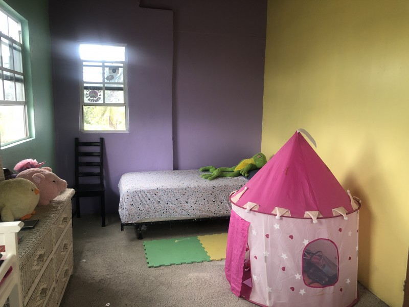 Other side of bedroom with 2 twin beds